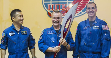 Olympic Torch Takes Its First Spacewalk